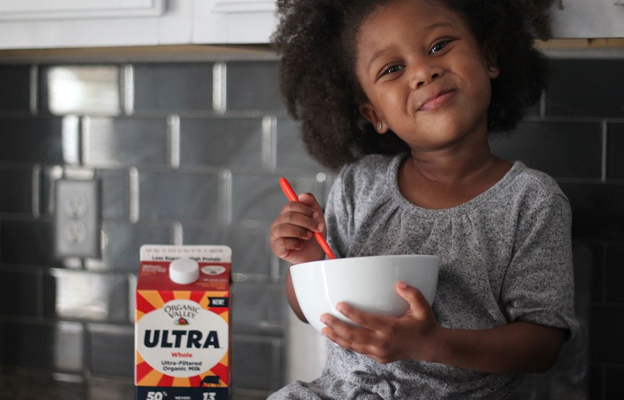 Girl enjoying Organic Valley Ultra Milk.